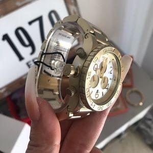Nixon 48-20 brand new in box. Beautiful watch.